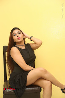 Tollywood Upcoming Actress Pooja Roshan Stills in Black Short Dress at Plus 1 Movie Trailer Launch  0276.JPG
