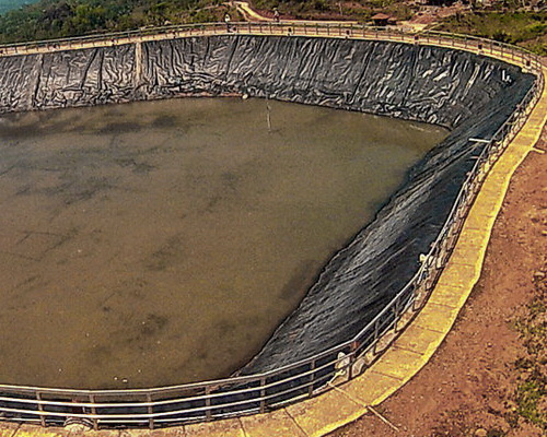 Tinuku.com Embung Nglanggeran geomembrane constructed to collect rainwater for agricultural water supply