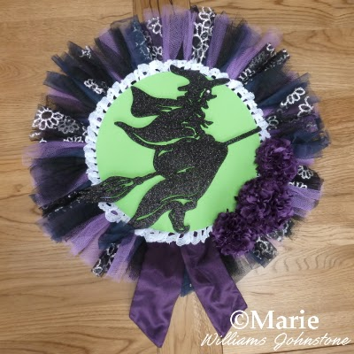 Witchy wreath design with netting and fabric pom poms