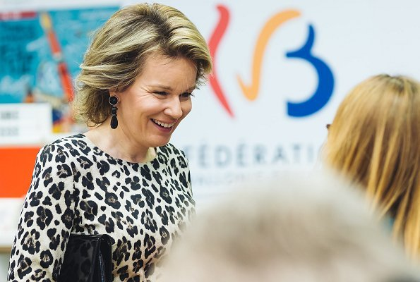 Queen Mathilde is wore her Natan leopard-print dress, Armani satin clutch