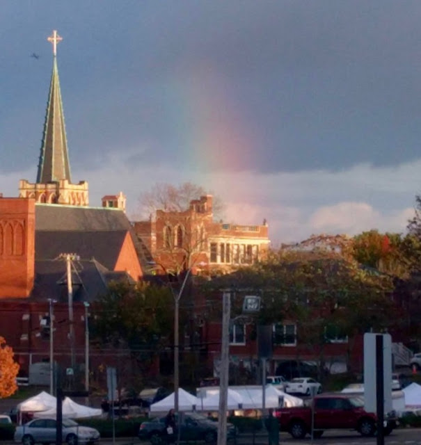 Rainbow in background, Arlington Farmers Market in foreground church steeple at left