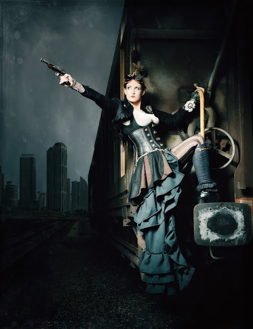 steampunk fashion (women's clothing, goggles, gun, skirt, blouse, corset, boots)