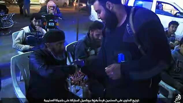 Isis celebrates Brussels terror attack by sharing sweets on the street.