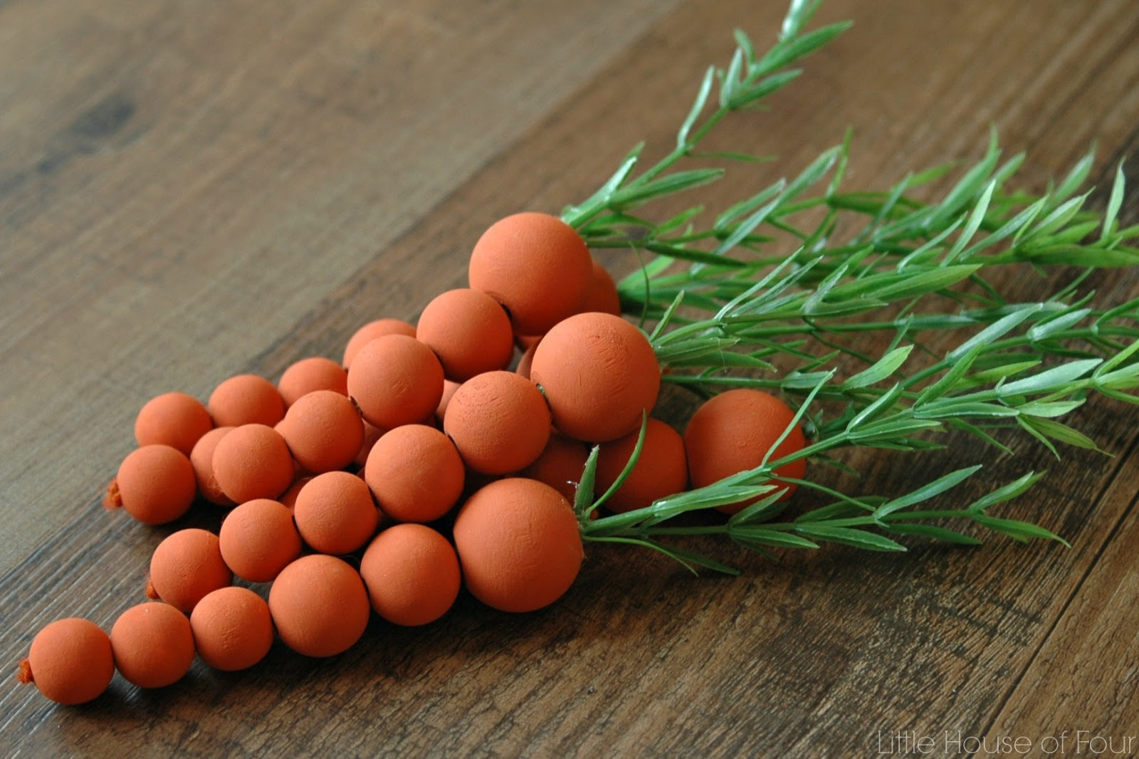 orange wooden carrots made from craft beads