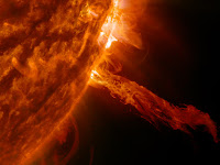 A stream of plasma burst out from the Sun