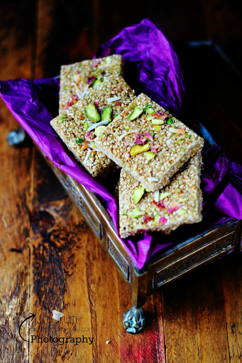 rose, pistachio, coconut til gajak video recipe - this moreish winter treats, only takes 30 minutes to prepare and not required tons of ingredients, an ideal dish for makarsankranti and lohri.