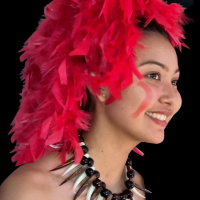 Nina smiles in her dance costume headpiece profile