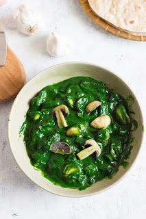 Mushrooms cooked in a vibrant spinach curry