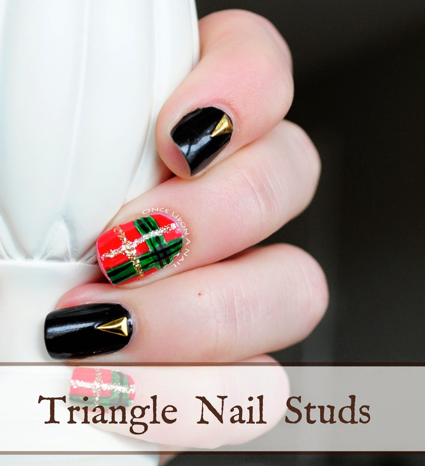 http://onceuponnails.blogspot.com/2014/12/christmas-plaid-and-nail-stud-review.html