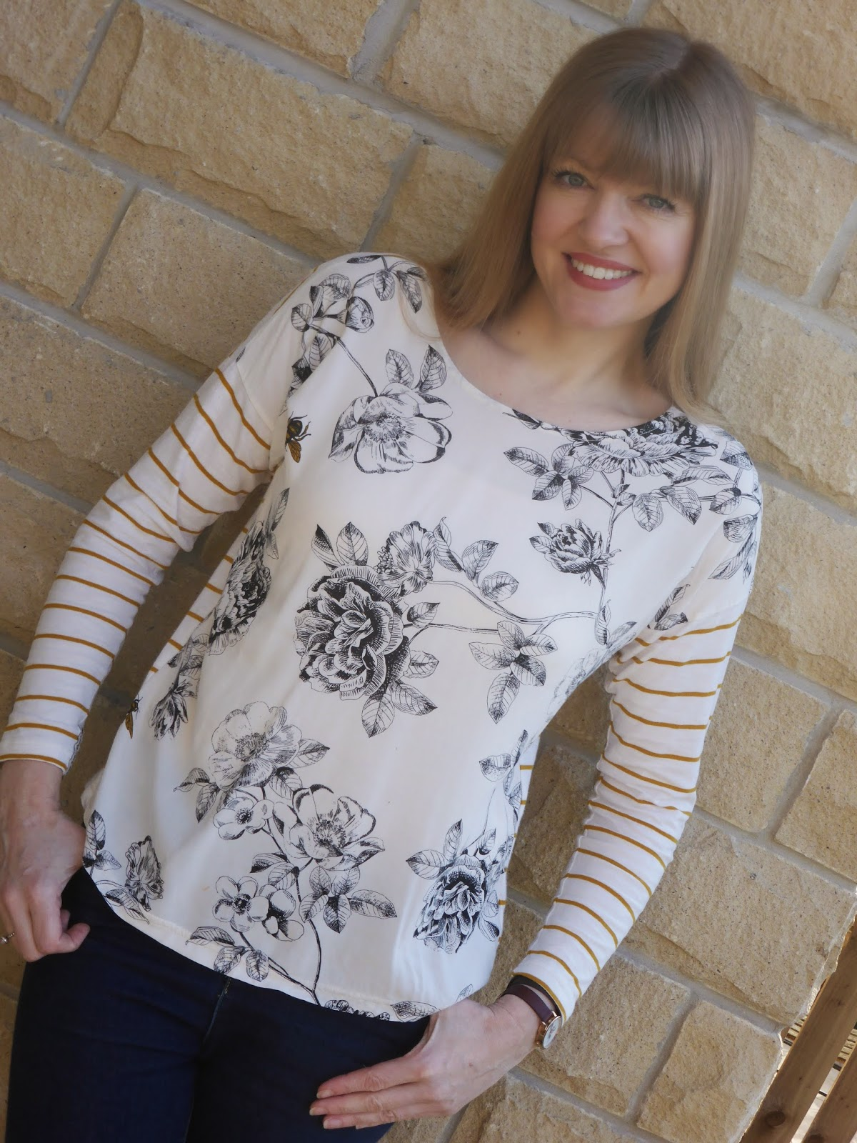 What Lizzy Loves blogger wearing Joules striped top with bees