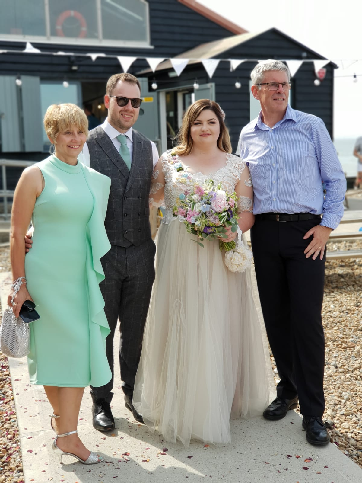 The father of the bride and his wife with the happy couple: Whitstable, UK, August 2018