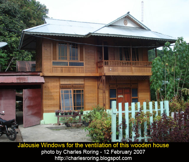 Wooden house in Indonesia with glass windows
