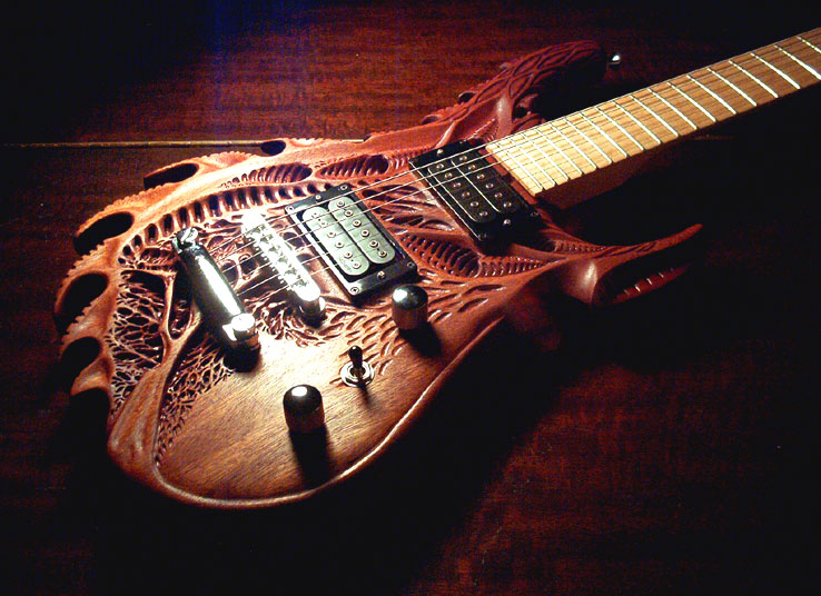 simply creative incredible carved guitar. Black Bedroom Furniture Sets. Home Design Ideas