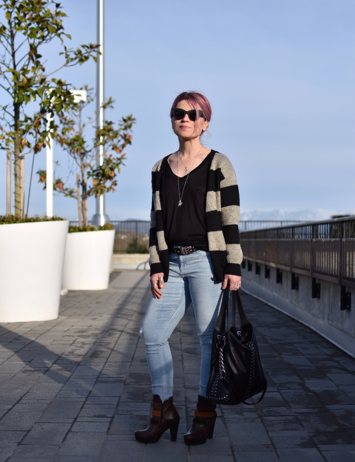 Monika Faulkner outfit inspiration - styling a striped grandpa cardigan with a slouchy tee, distressed skinny jeans, and platform booties