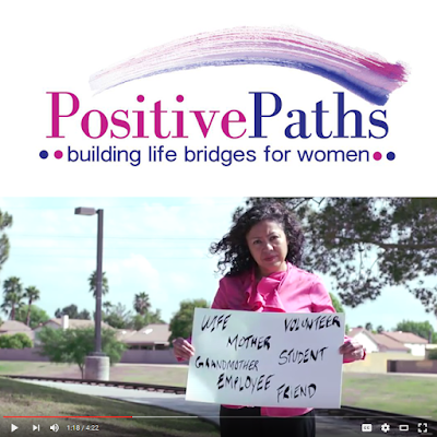 Logo for Positive Paths.  Video clip of a woman holding a sign that reads: Wife, Mother, Volunteeer, Grandmother, Student, Friend, Employee, Woman