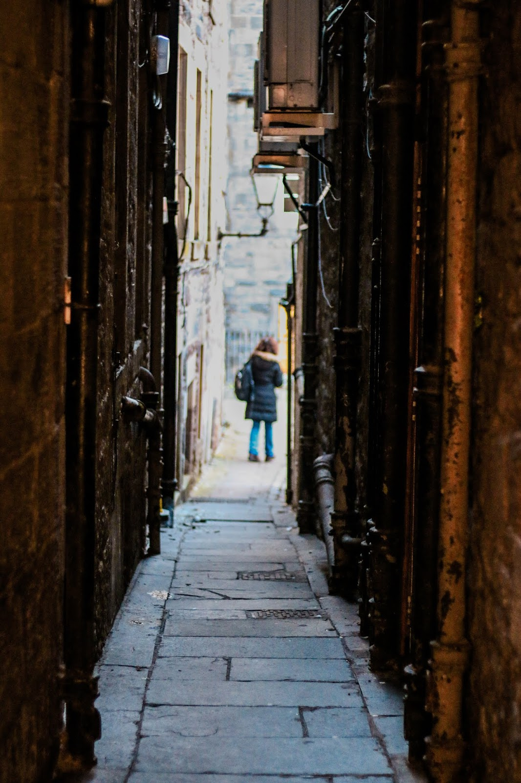 a photo of an alleyway in Edinburgh with someone standing at the bottom of it