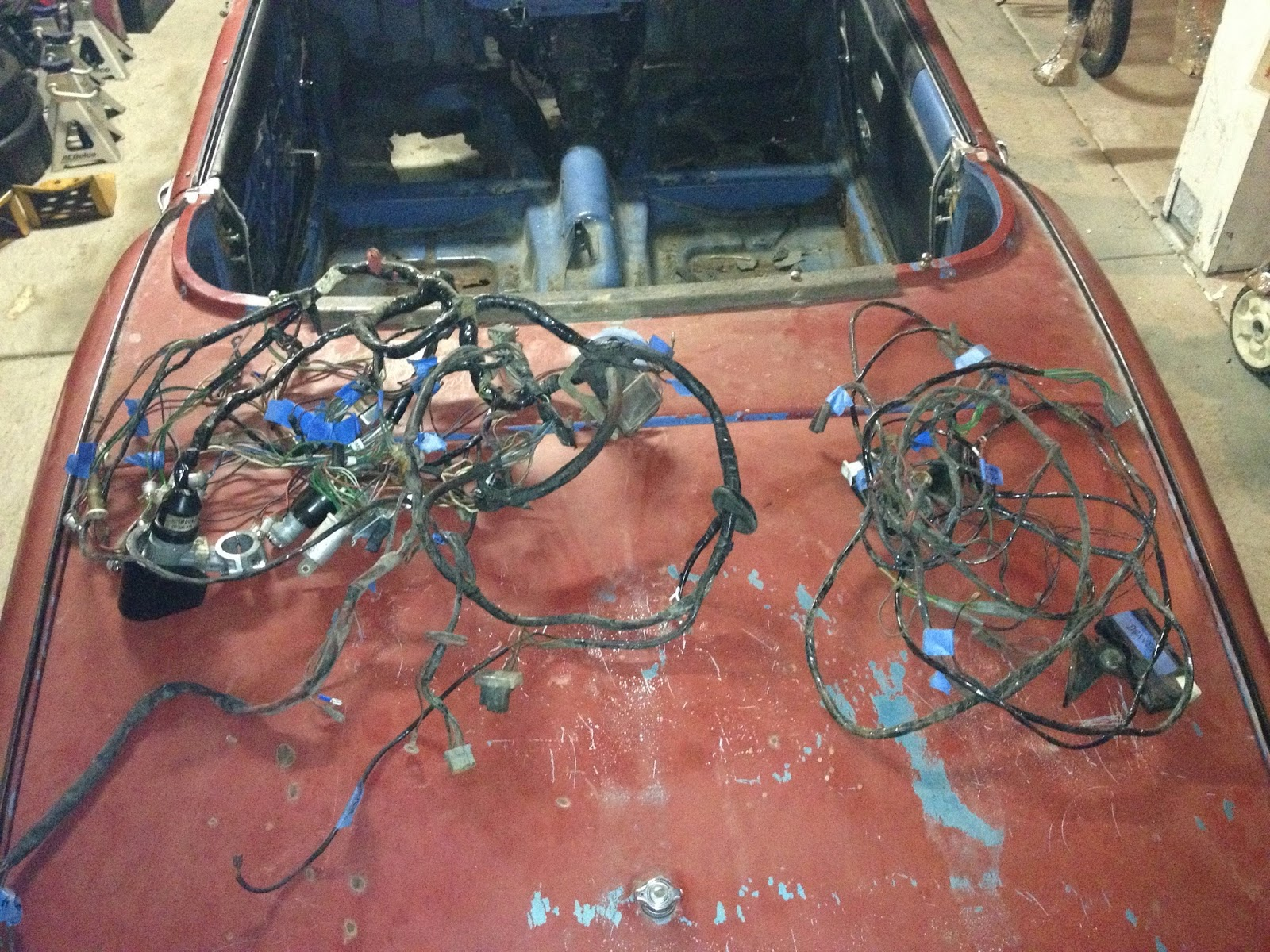 hight resolution of the wiring harnesses are out the one on the right is the rear harness with the seatbelt switches while the one on the left is the main harness with the