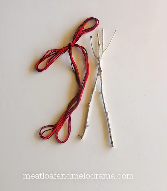 red embroidery floss and twigs painted white