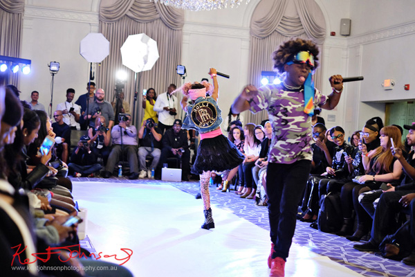 Grand finale coming up, King Imprint & Kandi Reign Dance It Up LIVE at NYFW - Photographed by Kent Johnson for Street Fashion Sydney.