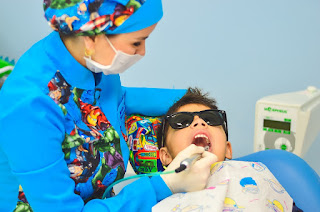dental hygienist working on a child