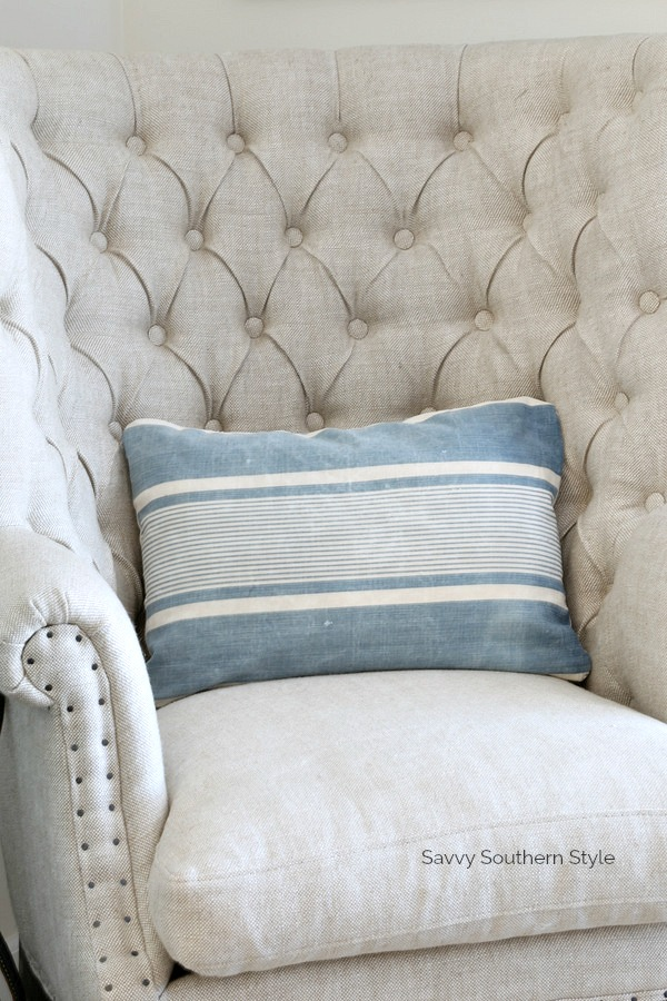 tufted club chair, French Ticking pillow