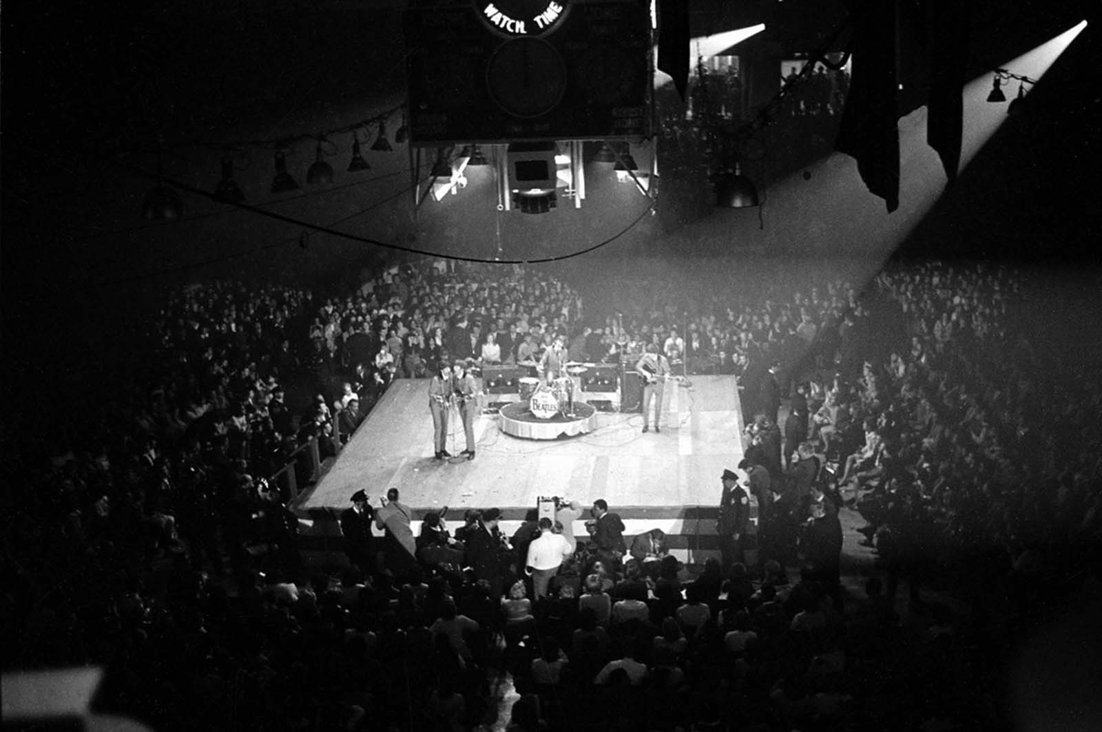 The Beatles perform at the Coliseum in Washington, District of Columbia, during their first American tour.