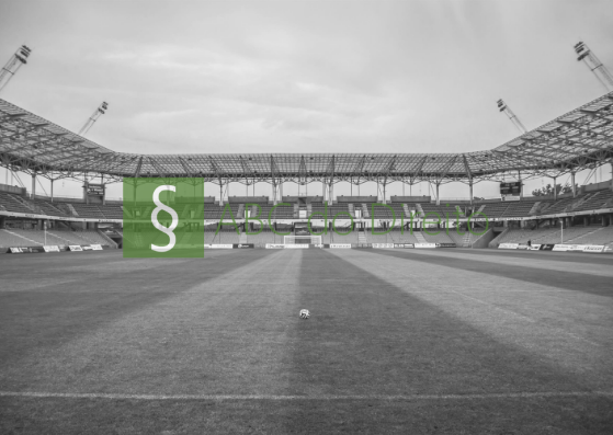 Estadio de futebol mostrado do gramado e vendo parte da arquibancada