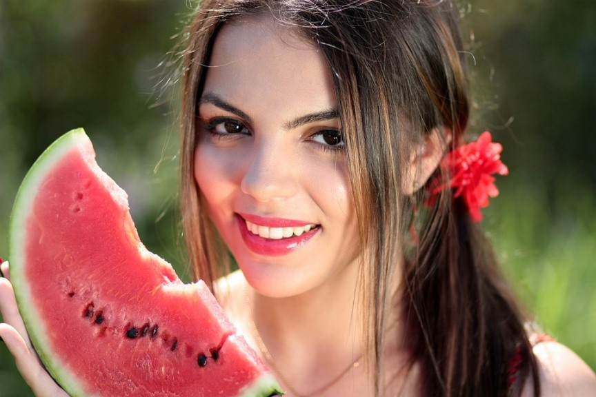 smiling beautiful woman with a piece of watermelon.jpeg