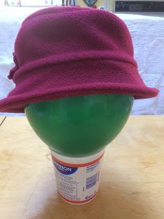 Maroon fleece hat with downturned brim