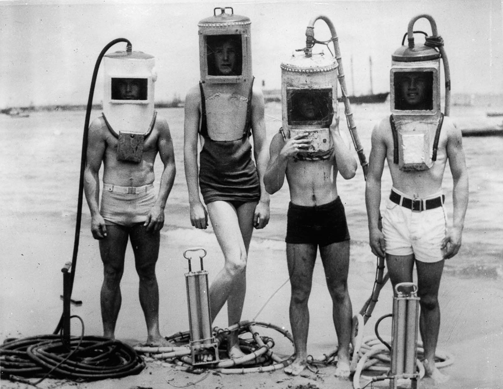 A group of Los Angeles boys show off diving helmets made from sections of hot water heaters, boilers and other easily secured junk. 1933.