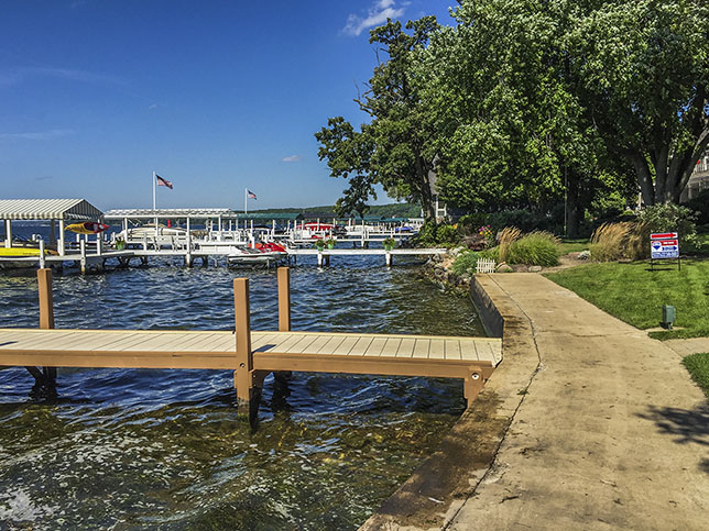 concrete paved trail along water and dock