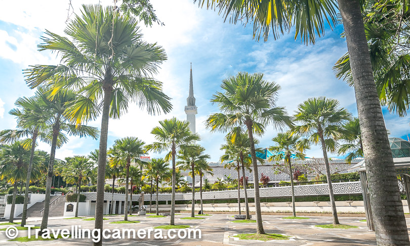 This photograph shows the green & open space of National Mosque in Kuala Lumpur. These high trees make this place more beautiful and desirable. Weather was not favorable otherwise I would have sat here and spent some time around this green patch in the middle of the city with skyscrapers.