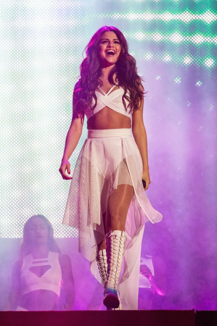 Selena Gomez performs in an all white outfit at the Borderfest Concert in Texas