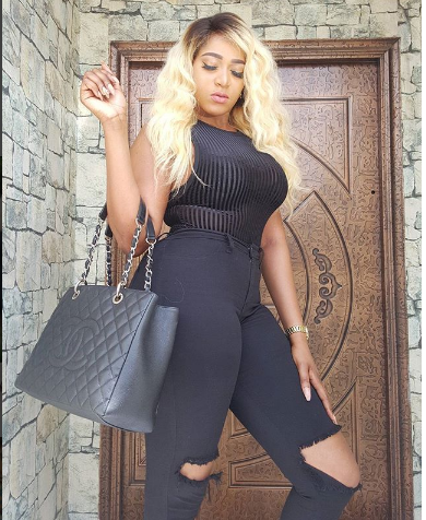 Busty Rukky Sanda shows off her hourglass figure in all black