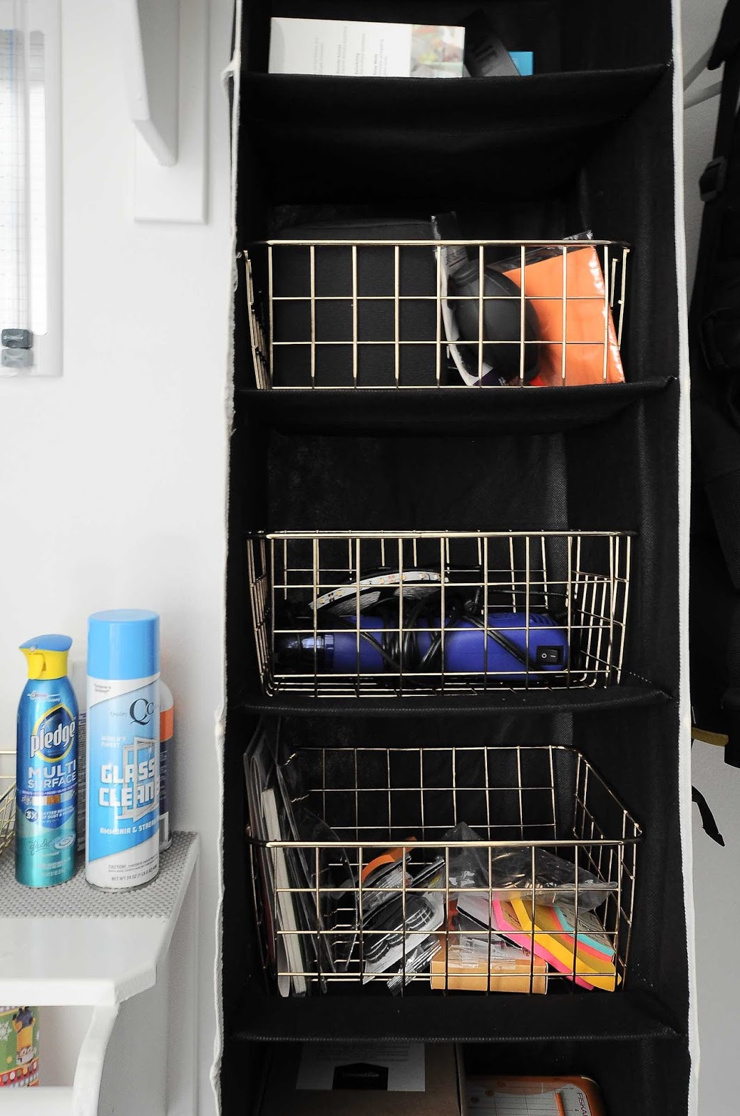 Genius! Use a shoe organizer as a way to store craft and office supplies in a home office closet.