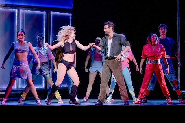 joanne clifton and the flashdance cast mid-routine on stage