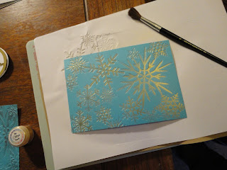 Turquoise background with gold mica snowflakes