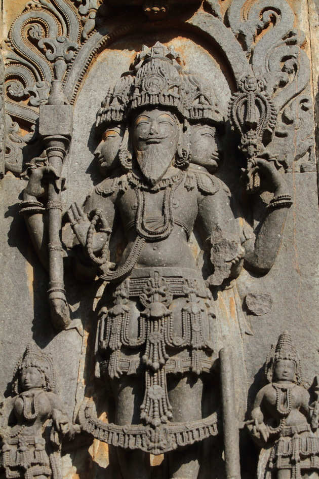 Tridev - Brahma, Vishnu and Shiva in one statue at Hoysaleswara temple, Halebid, Karnataka