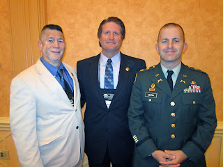 Doug Dretke, Director of the Correctional Management Institute of Texas (center) greets Peter Grande (left), retired lieutenant colonel and Chief of State at the Military Corection Complex at Fort Leavenworth, Kansas,  and Major Andrew Deaton (right), Battalion Commander of the 40th Military Police Battalion (Internment/Resettlement) (Rear) (Provisional) at the American Correctional Associations' Military Reception in August.