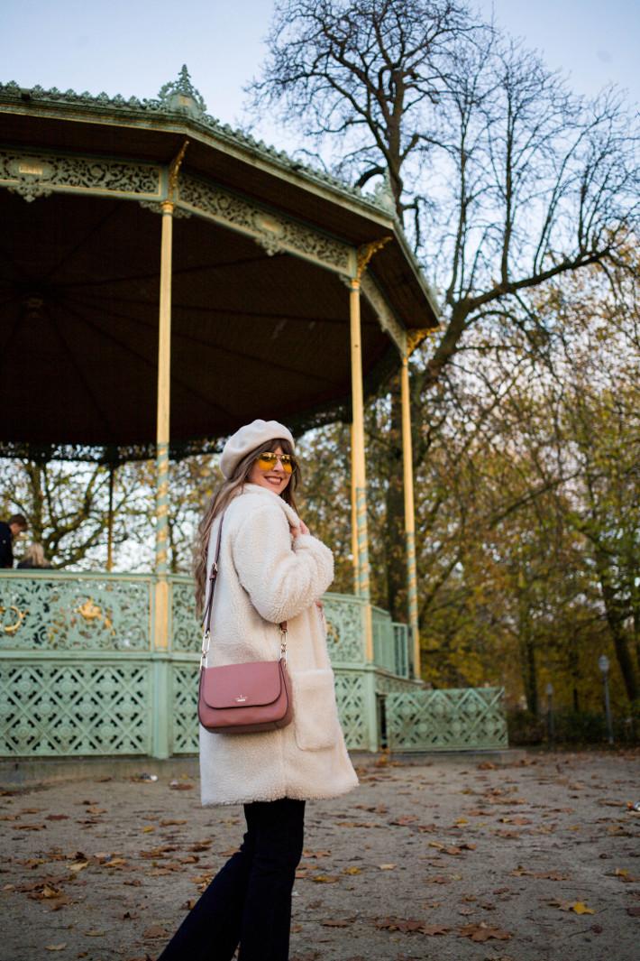 pink kate spade bag, teddy coat, beret, yellow pilot glasses