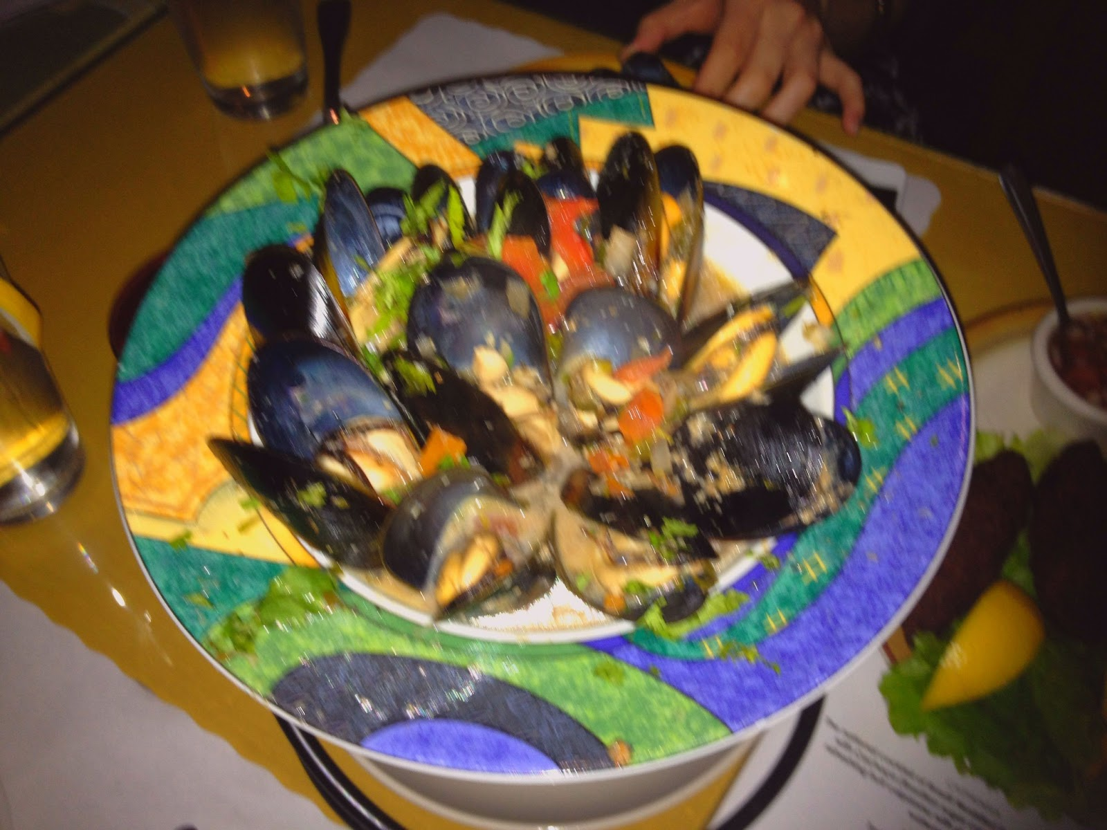 Mussels sauteed in red wine, olive oil, lemon and garlic