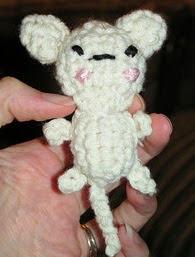http://www.ravelry.com/patterns/library/mini-amigurumi-kitty