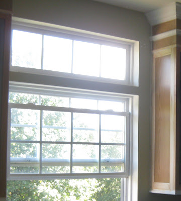 give your kitchen cabinets a better look with moldings- end cabinet design - kitchen window
