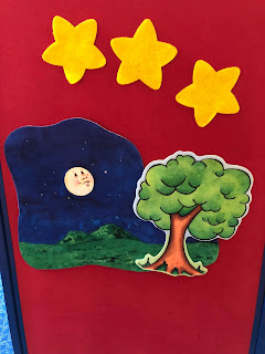 Flannel board with 3 stars, a nighttime scene, and a tree
