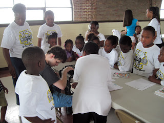 Taylor demonstrates Pacmate to summer day campers