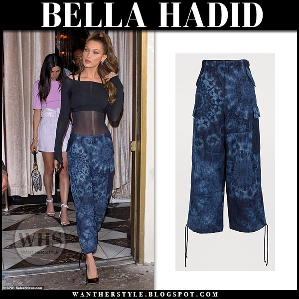 8fa7c7bc9d185 Bella Hadid in blue printed cargo Dior pants and black top. Celebrity  spring summer trend