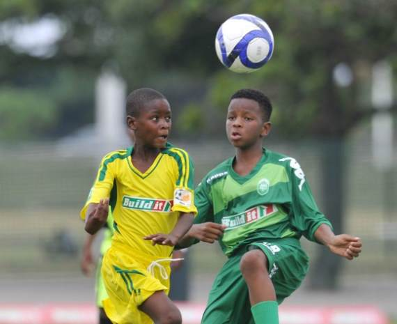 Children from AmaZulu Development playing Soccer