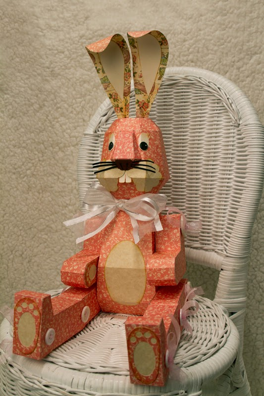 3D Button Jointed Bunny sitting in wicker chair