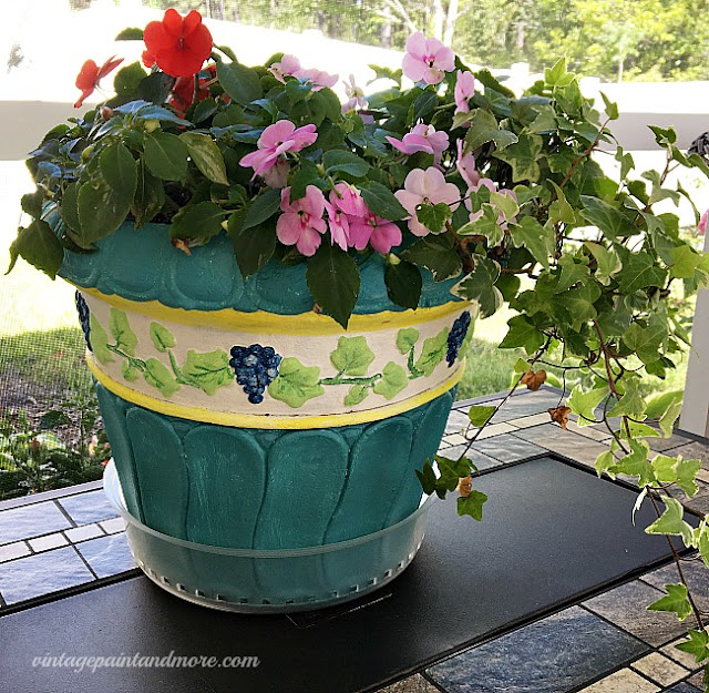 Vintage Paint and more... a composite flower pot made pretty with a craft paint
