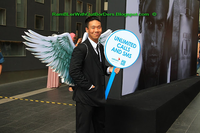 Men in business suit with angle wings, Pavilion Mall, Bukit Bintang, KL, Malaysia